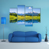 Idyllic summer landscape with clear mountain lake in the Alps multi panel canvas wall art