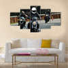 Biker on road with helmet and wet asphalt Multi panel canvas wall art