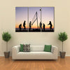people playing beach volleyball on the beach in Brittany Multi panel canvas wall art