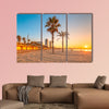 Barceloneta Beach in Barcelona with colorful sky at sunrise Multi panel canvas wall art