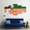 Tennis players playing a match on the court on a sunny day Multi panel canvas wall art