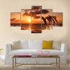 beautiful sunset with dolphins jumping multi panel canvas wall art