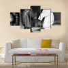 Chess knights head to head. Black and white image multi panel canvas wall art