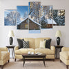Old houses in snowy forest Multi panel canvas wall art