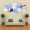 Young man jumping and playing street ball basketball Urban authentic Multi panel canvas wall art