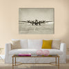World War II era heavy bomber front view stained old photo Multi Panel Canvas Wall Art