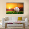 Golf ball on the lawn in sunset lights Multi Panel Canvas Wall Art