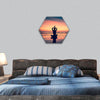 Silhouette of woman practicing yoga hexagonal canvas wall art