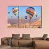 Balloons flying over rock landscape multi panel canvas wall art