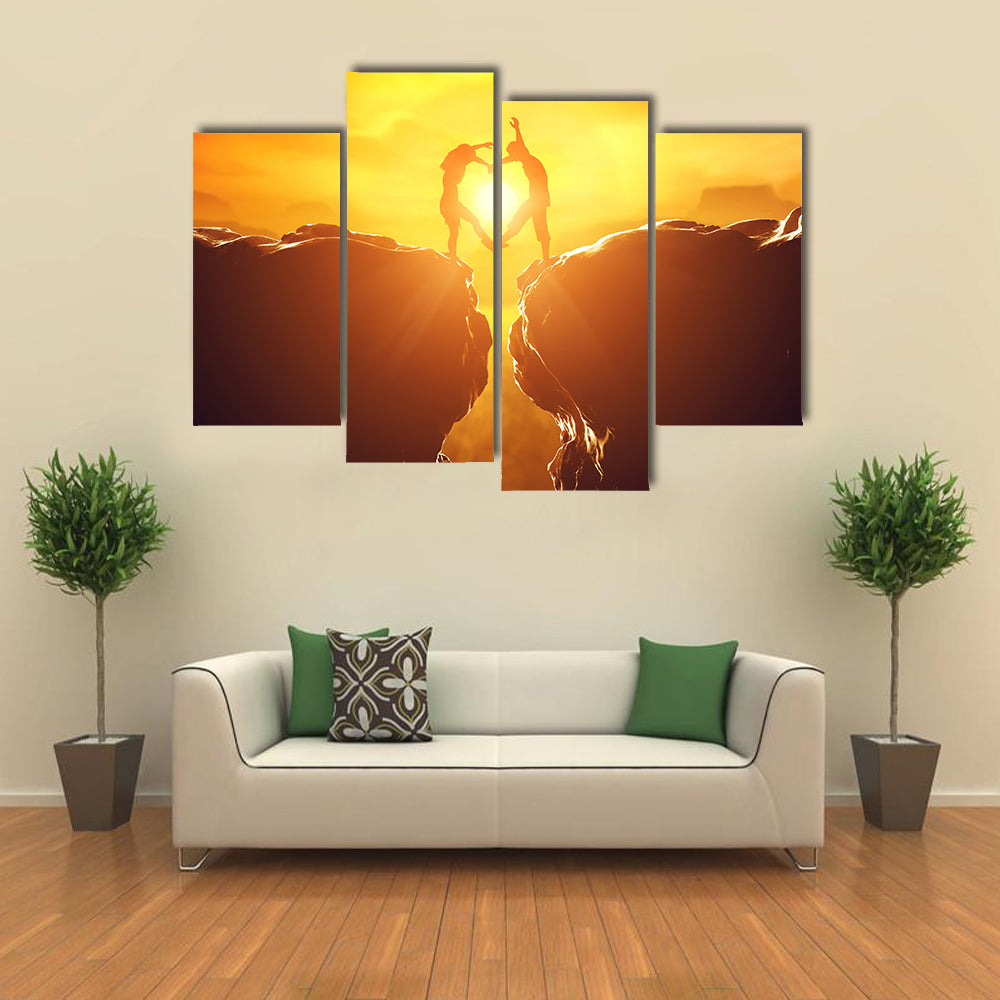 Happy couple making heart shape over precipice multi panel canvas wall art