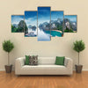 Tourist junks floating among limestone rocks at Ha Long Bay South China Sea Vietnam Southeast Asia Multi panel canvas wall art