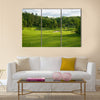A golf green with bunkers with backdrop of trees Multi Panel Canvas Wall Art