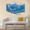 Snowy blue mountains in clouds Multi panel canvas wall art