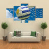 Uruguay flag and soccer ball, football in goal net Multi panel canvas wall art