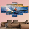 A male waterskiing on a beautiful lake Multi panel canvas wall art
