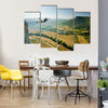 Base-jumper Jumps from the Cliff at Sunrise in the Mountains Multi Panel Canvas Wall Art