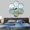 Jumper jumps from the cliff at sunrise hexagonal canvas wall art
