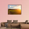Beautiful sunset over the green large field Multi panel canvas wall art