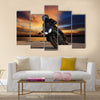 Young man riding big bike motorcycle on asphalt highways road Multi panel canvas wall art