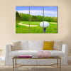 Golf ball on course with beautiful blurry landscape Multi Panel Canvas Wall Art