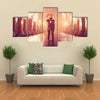Couple with umbrella kissing at night alley multi panel canvas wall art