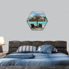 White sand beach with lagoon and the tropical island hexagonal canvas wall art