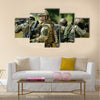 Team of soldiers engaged in the exploration of the forest Multi Panel Canvas Wall Art