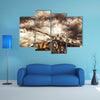 German Tank In Action With Storms In Background Multi Panel Canvas Wall Art