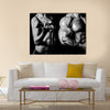 Bodybuilding, Strong man and a woman posing on a black background, Multi panel canvas wall art