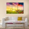 Colorful butterflies flying over spring meadow with flowers Multi Panel Canvas Wall Art