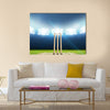 A cricket stadium with cricket pitch Multi panel canvas Wall art