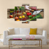 Various Paleo diet products on wooden table, top view Multi panel canvas wall art