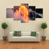Hot lava stream is flowing into the ocean, Hawaii, Big Island multi panel canvas wall art