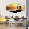 Silhouettes of Team on Mountain Peak Sport and Active Life Concept Multi Panel Canvas Wall Art