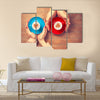Women and man holding cups of coffee with heart shape symbol Multi Panel Canvas Wall Art