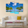 Tropical beach resort with lounge chairs and umbrellas in Mauritius Multi panel canvas wall art