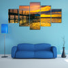 An old floating restaurant view in sunset multi panel canvas wall art