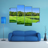 Green golf course in a sunny day, Thailand multi panel canvas wall art