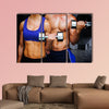 Bodybuilding couple against dark room Multi panel canvas wall art