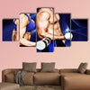 Bodybuilding couple against blue wave Multi panel canvas wall art