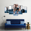 Close up portrait of a muscular man workout with barbell at gym, Multi panel canvas wall art