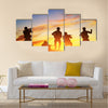 Soldiers in assault shooting with weapon, rifle at sunset. War, army, military Multi Panel Canvas Wall Art