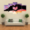 Silhouette hand in heart shape and beautiful sky multi panel canvas wall art