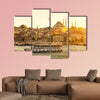 Tourist boat floats on the Golden Horn in Istanbul at sunset, canvas wall art