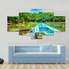 Old boat in tropical river, perfect place for fishing, Multi panel canvas wall art