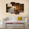 Cups of coffee with smoke and coffee beans on old wooden background Multi Panel Canvas Wall Art