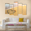 Heart drawn on the sand of a sea beach, soft wave and solar glare Multi panel canvas wall art