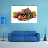 Chocolate with hazelnuts closeup Multi panel canvas wall art