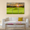 Golf ball on green Multi Panel Canvas Wall Art