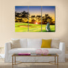 Golf equipment on green and hole as background Multi Panel Canvas Wall Art